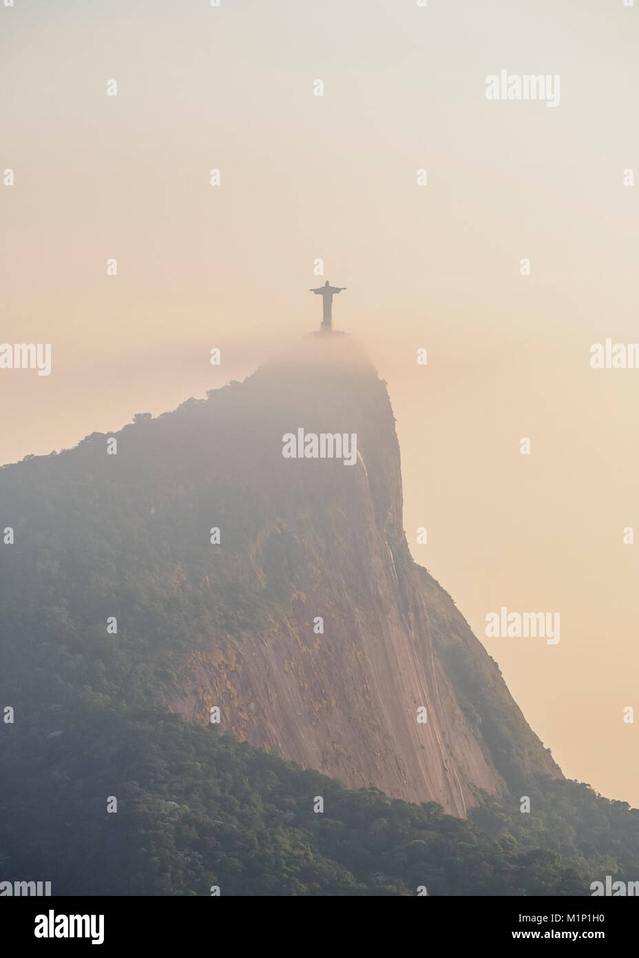 Christ the Redeemer and Corcovado Mountain at sunrise, Rio de Janeiro, Brazil, South America Stock Photo