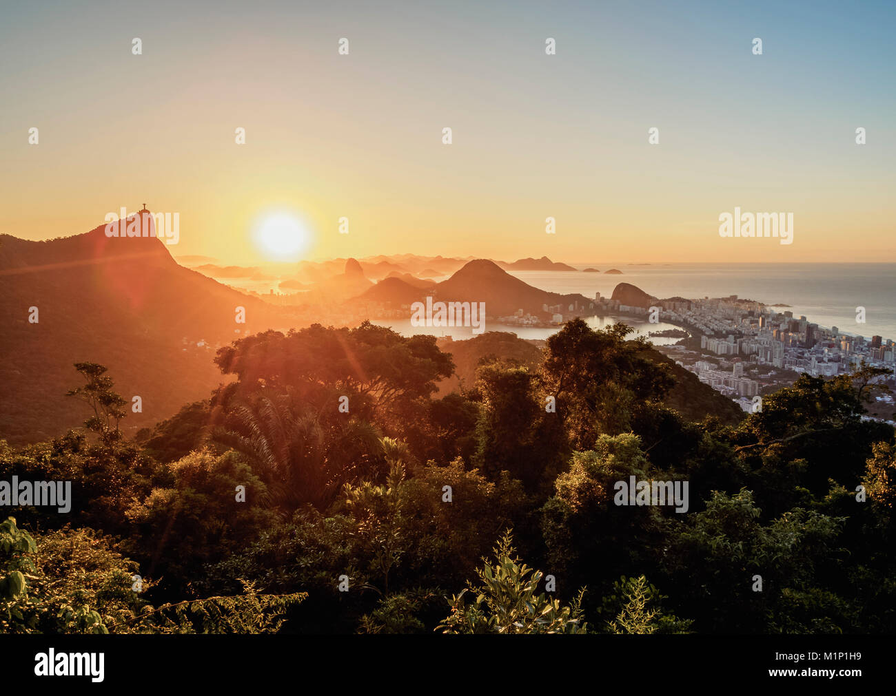 View from Vista Chinesa over Tijuca Forest towards Rio de Janeiro at sunrise, Brazil, South America Stock Photo