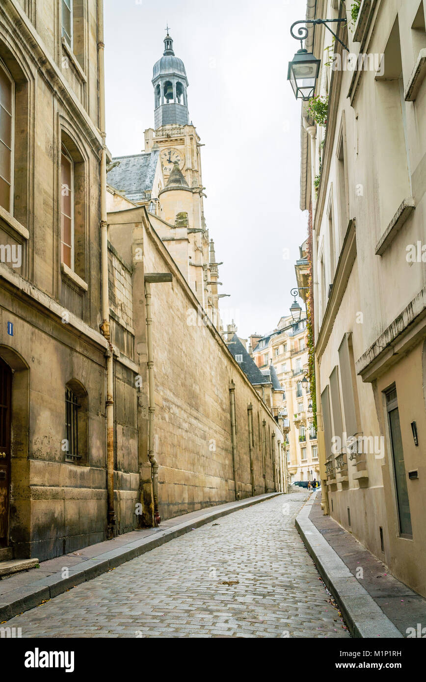 Paris quiet paved street and church in the 5th arrondissement district - Stock Image