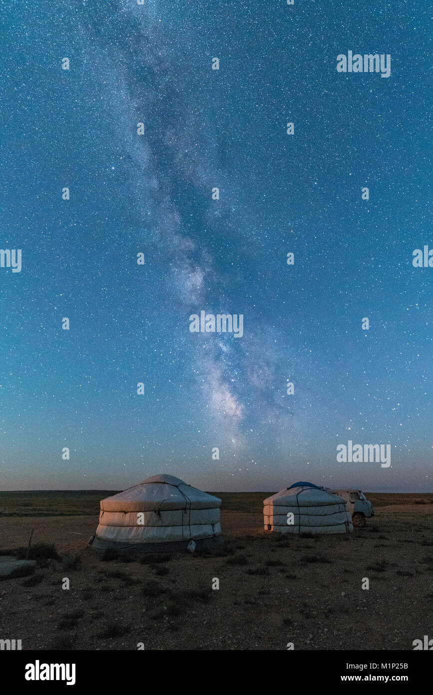 Mongolian traditional gers under the Milky Way, Ulziit, Middle Gobi province, Mongolia, Central Asia, Asia - Stock Image