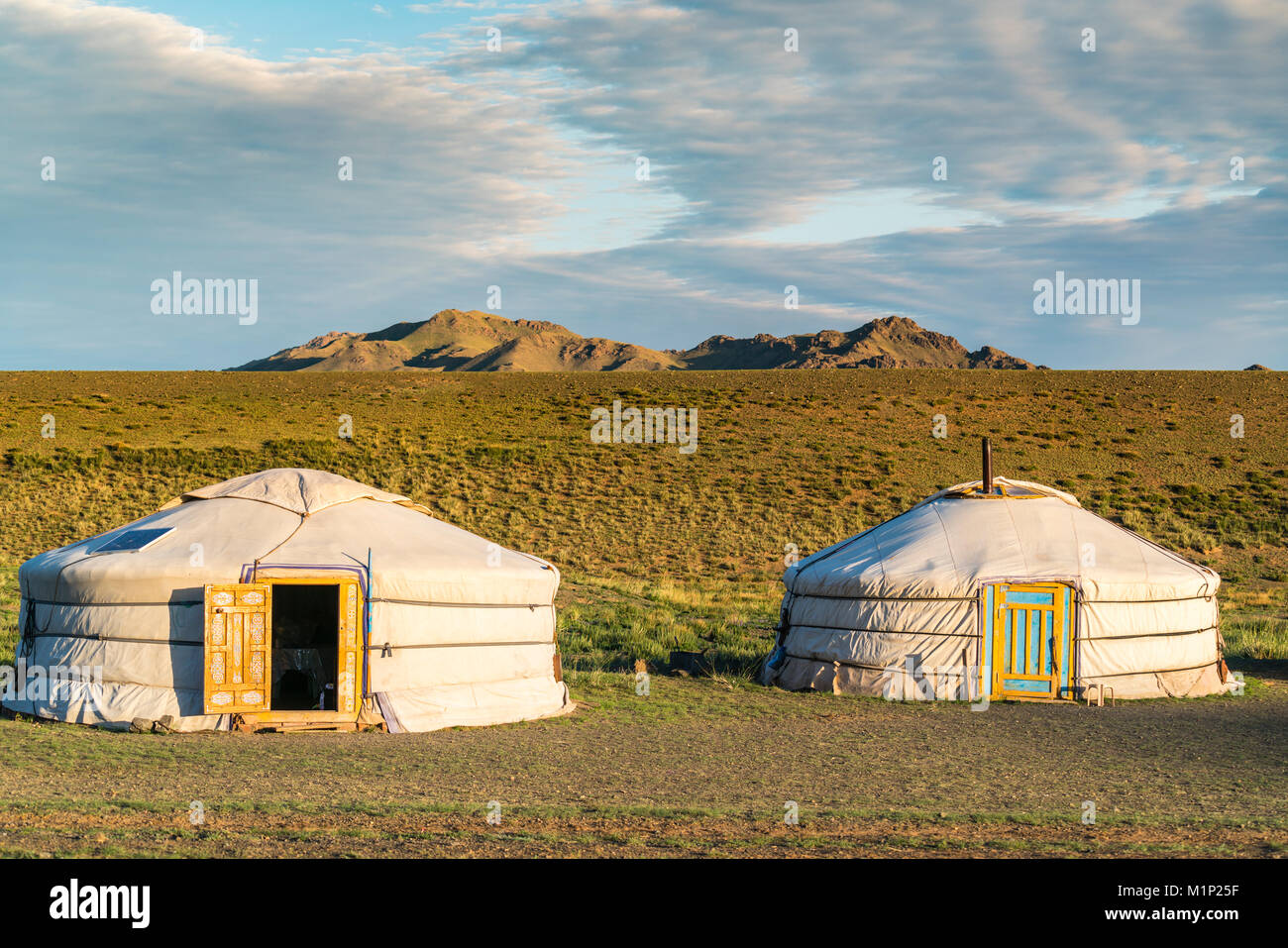 Two Mongolian nomadic gers and mountains in the background, Bayandalai district, South Gobi province, Mongolia, - Stock Image