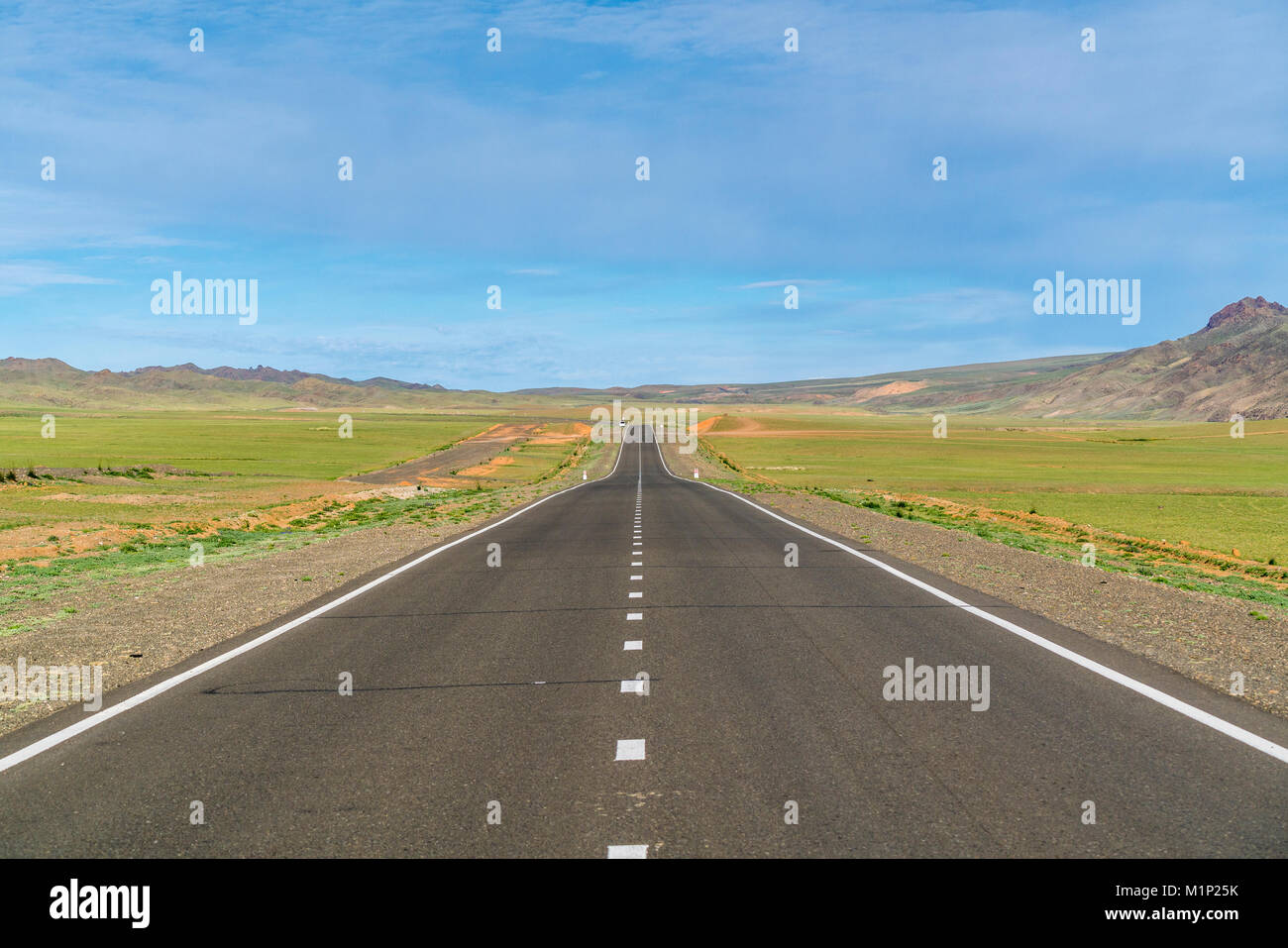 Straight paved road, Bayandalai district, South Gobi province, Mongolia, Central Asia, Asia - Stock Image