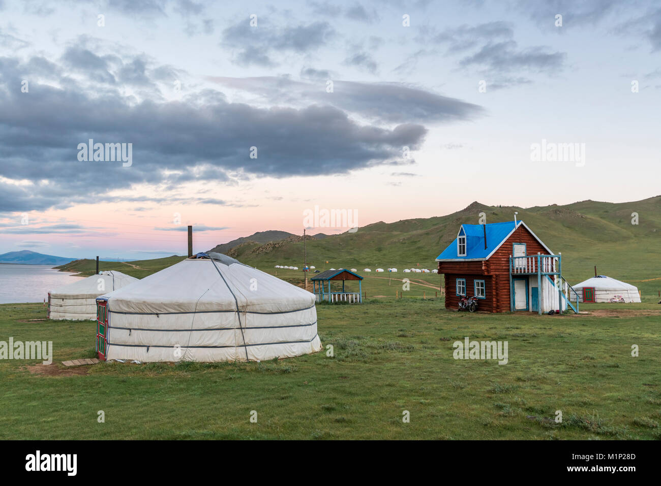 Wooden house and gers on the shores of White Lake, Tariat district, North Hangay province, Mongolia, Central Asia, - Stock Image