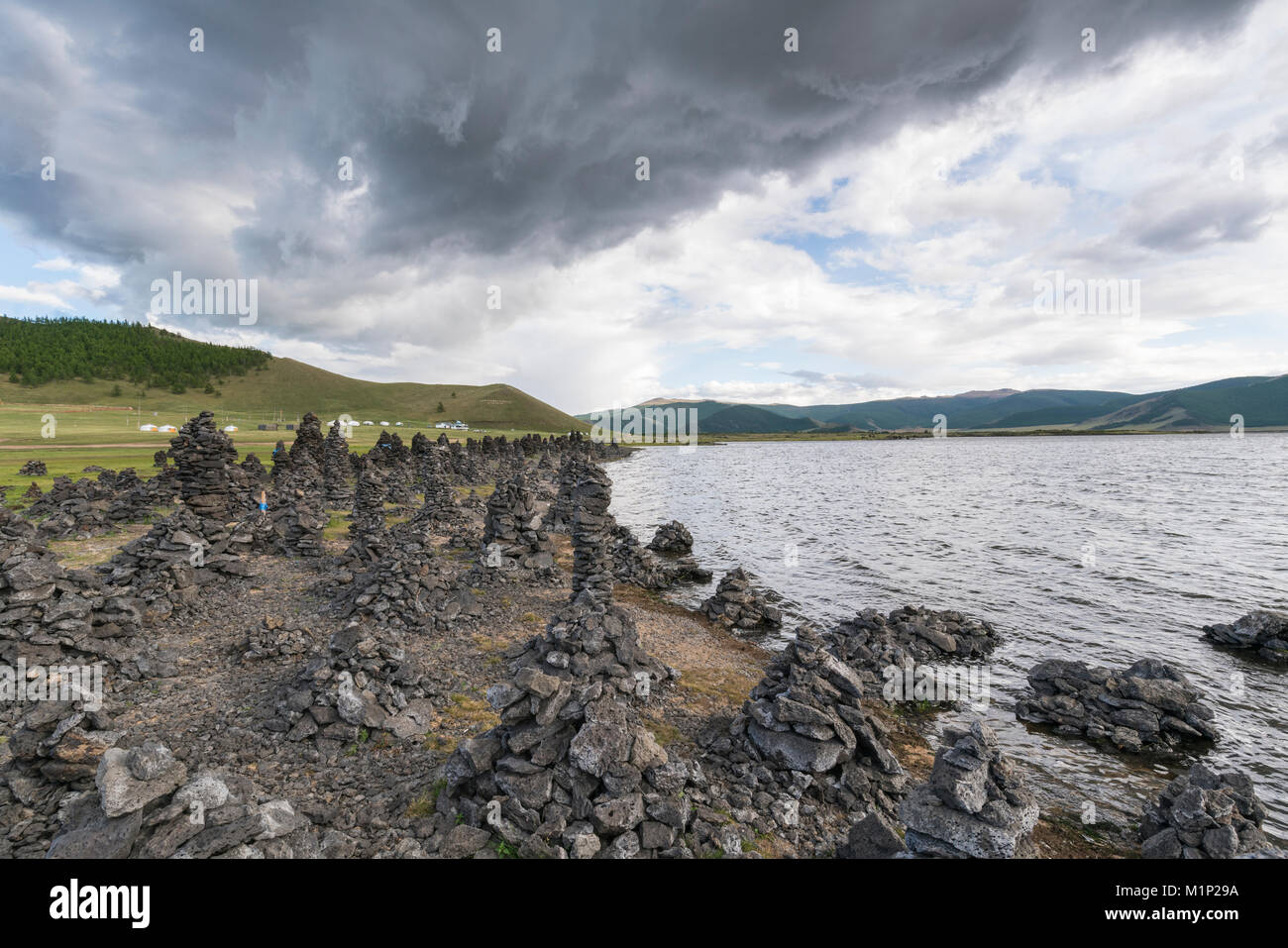 Volcanic rock formations on the shores of White Lake, Tariat district, North Hangay province, Mongolia, Central - Stock Image