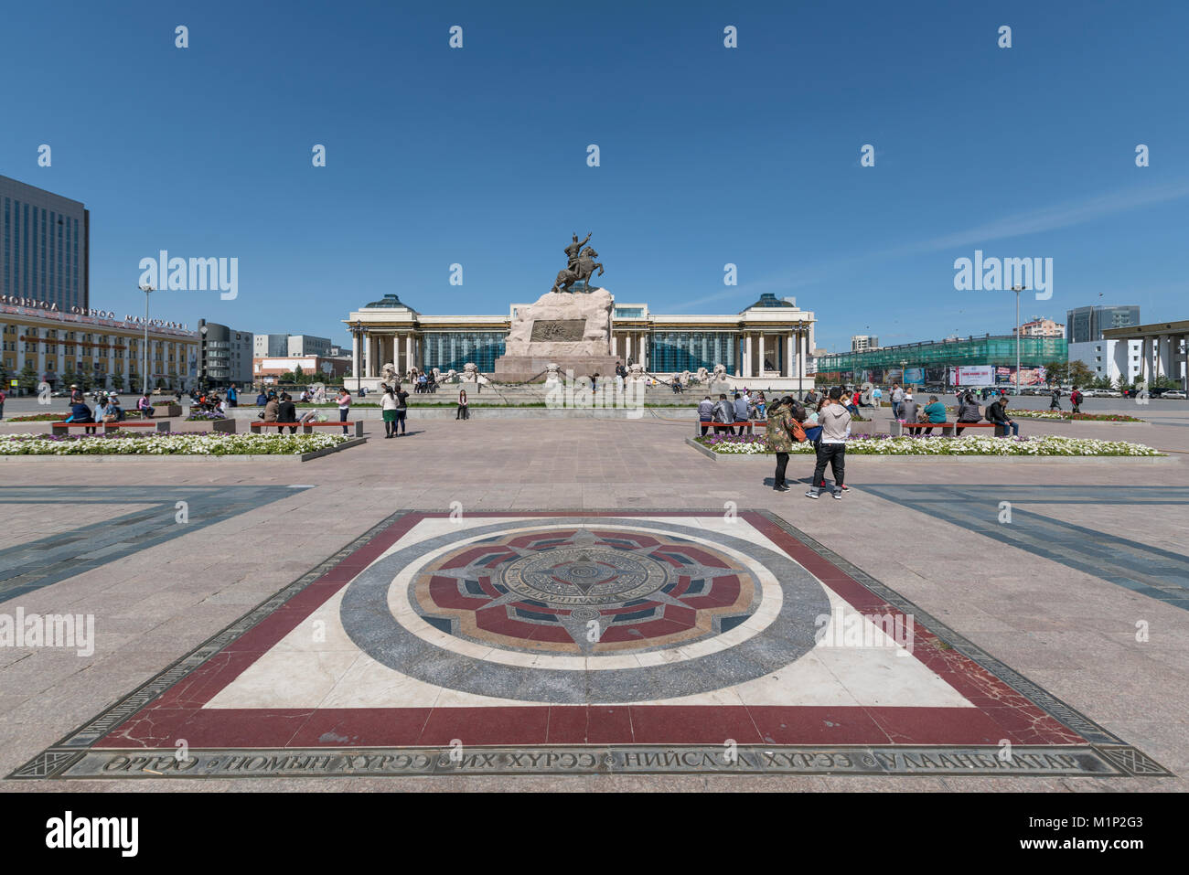 Tourists in Sukhbaatar square with Damdin Sukhbaatar statue, Ulan Bator, Mongolia, Central Asia, Asia - Stock Image