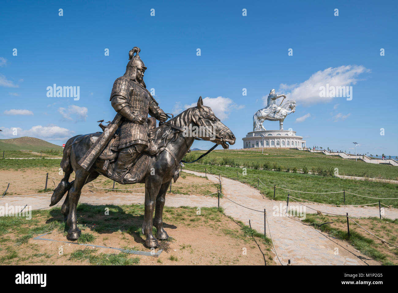 Statue of a Mongolian Empire warrior and Genghis Khan Statue Complex in the background, Erdene, Tov province, Mongolia, - Stock Image