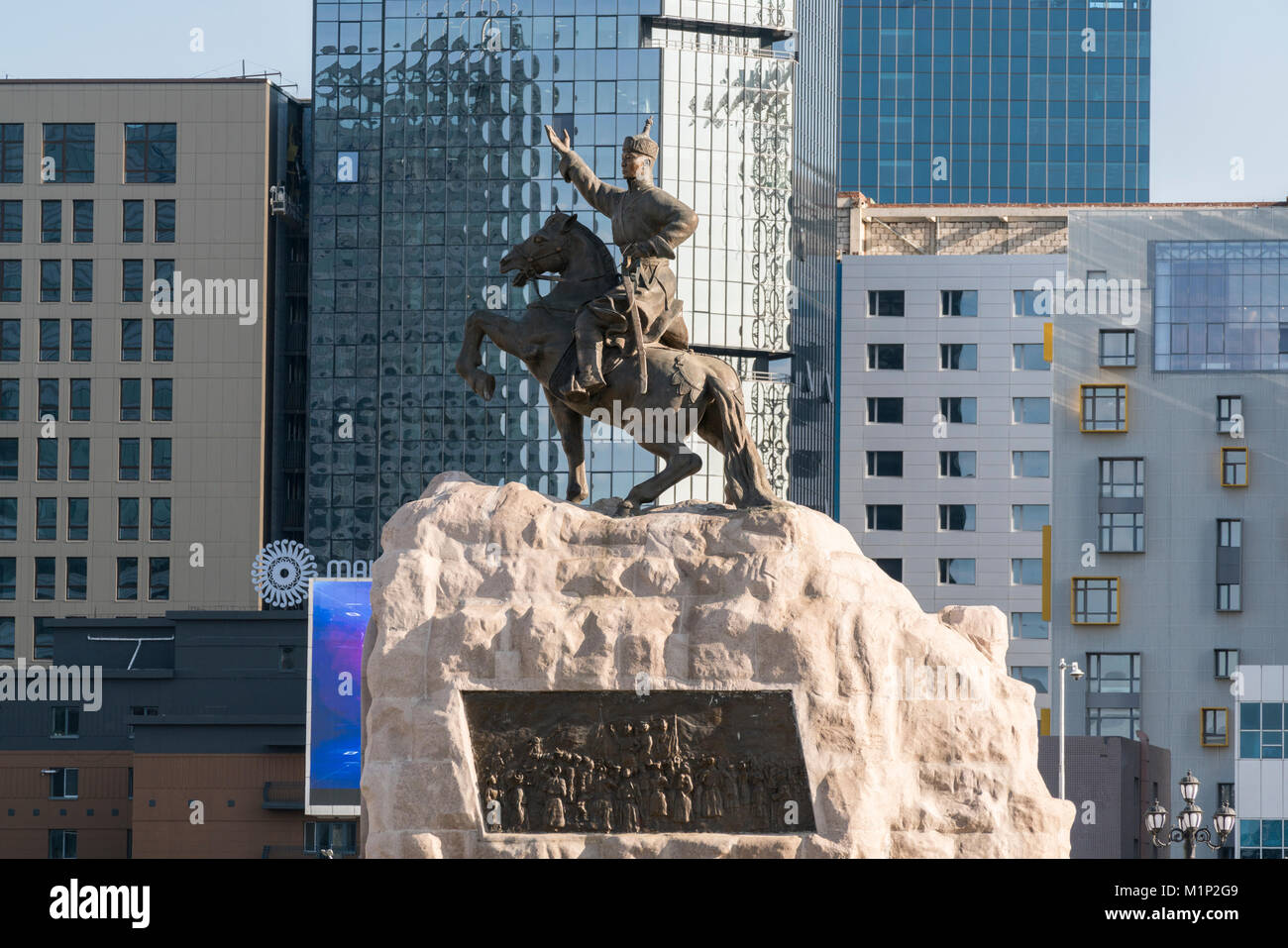 Damdin Sukhbaatar statue with skyscrapers in the background, Ulan Bator, Mongolia, Central Asia, Asia - Stock Image