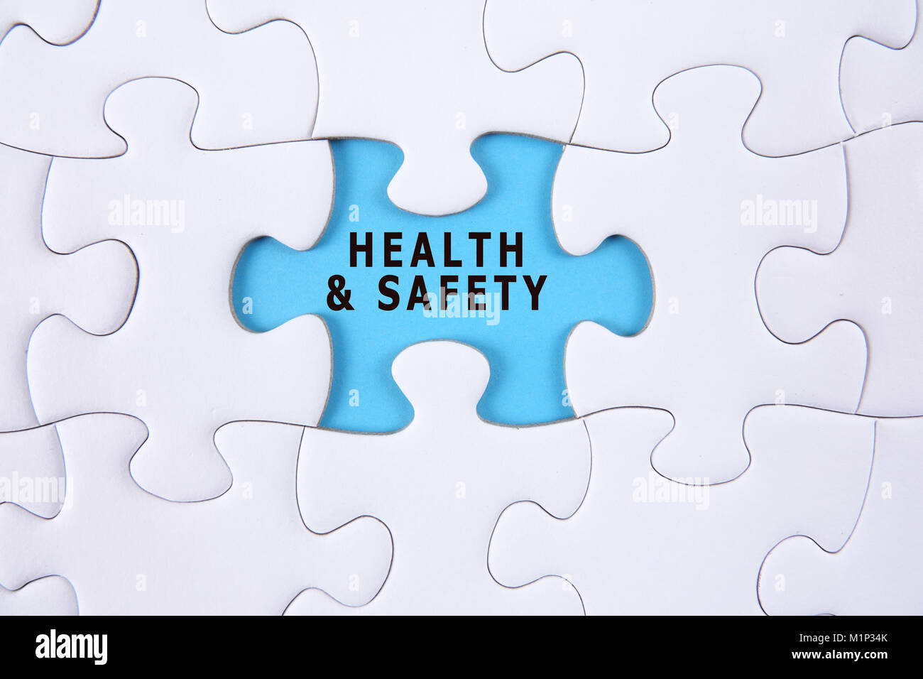 HEALTH AND SAFETY CONCEPT with white jigsaw puzzle Stock Photo ...