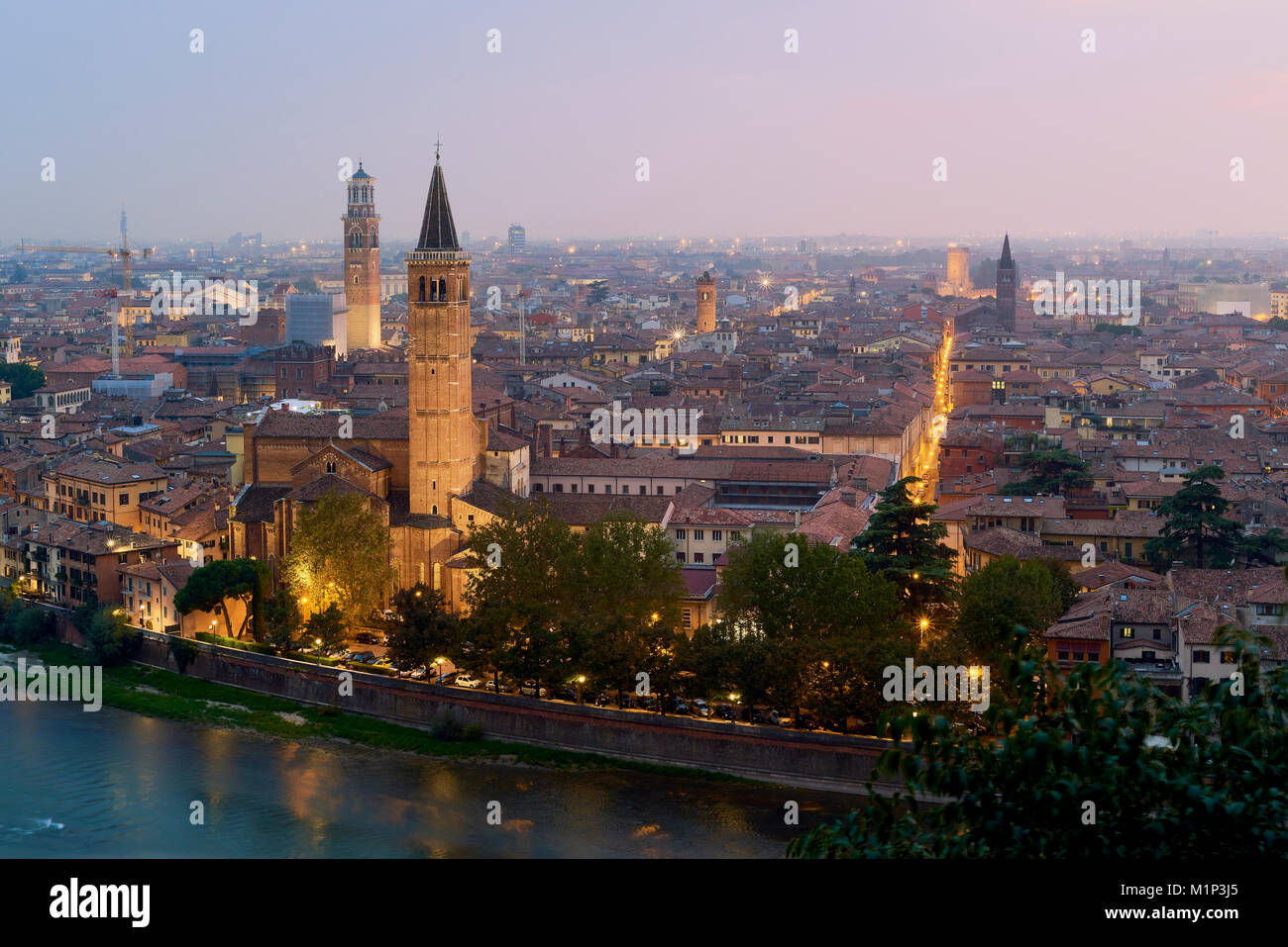 Cityscape at dusk seen from Castel San Pietro, Verona, Veneto, Italy, Europe - Stock Image