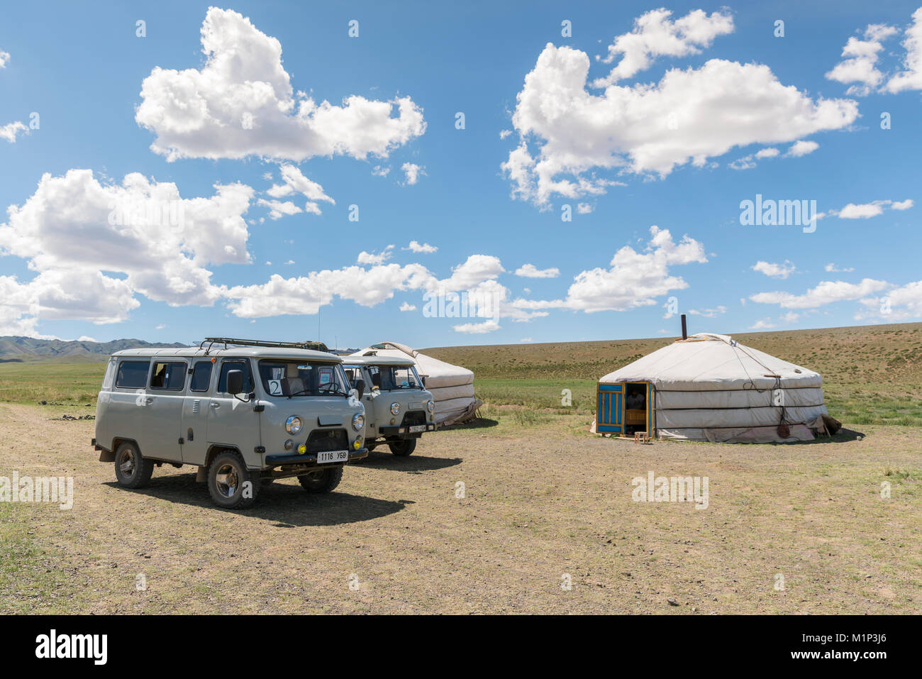 Mongolian traditional nomadic gers and soviet minivans. Bayandalai district, South Gobi province, Mongolia, Central - Stock Image