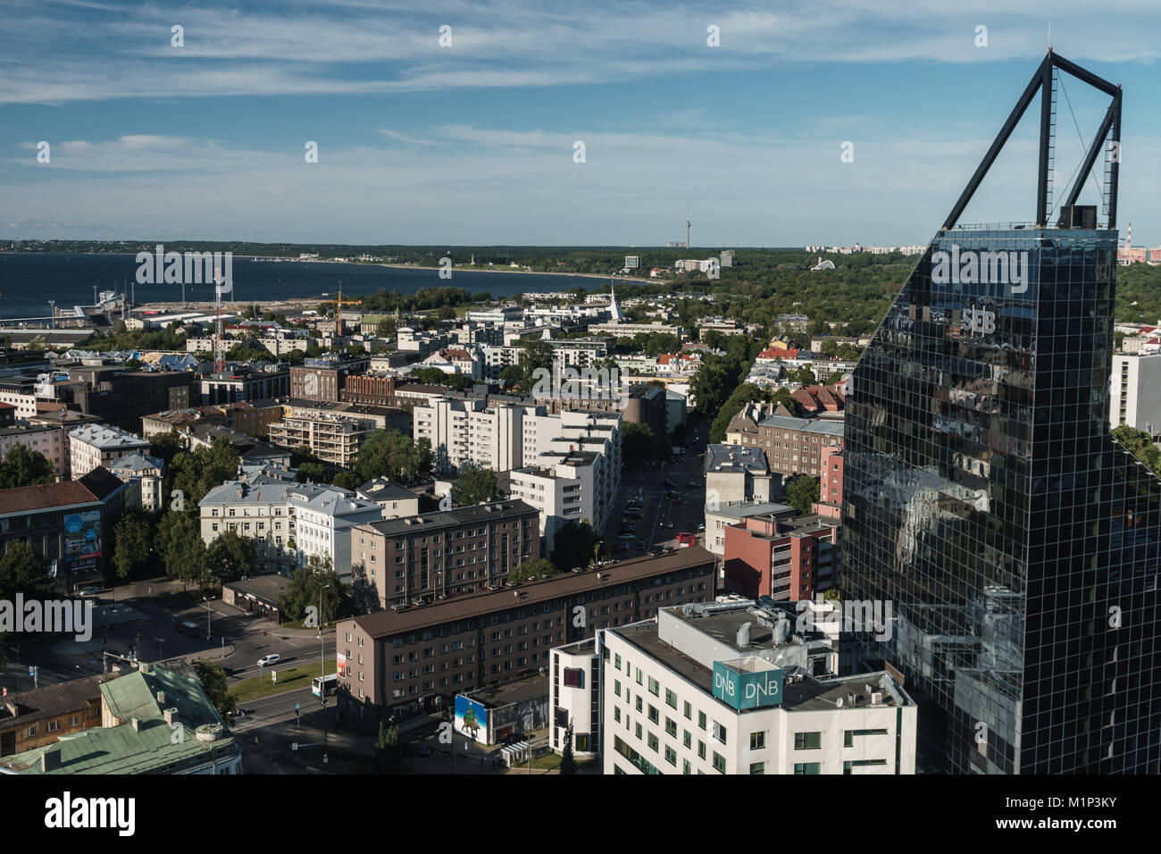 Cityscape of modern buildings and Baltic Sea, Tallinn, Estonia, Europe - Stock Image