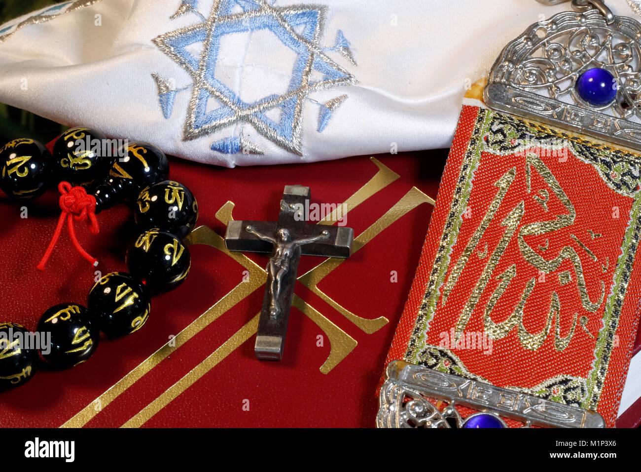Christianity, Buddhism, Islam and Judaism, interfaith symbols of Bible, crucifix, Kippah, Allah monogram and Mala, - Stock Image