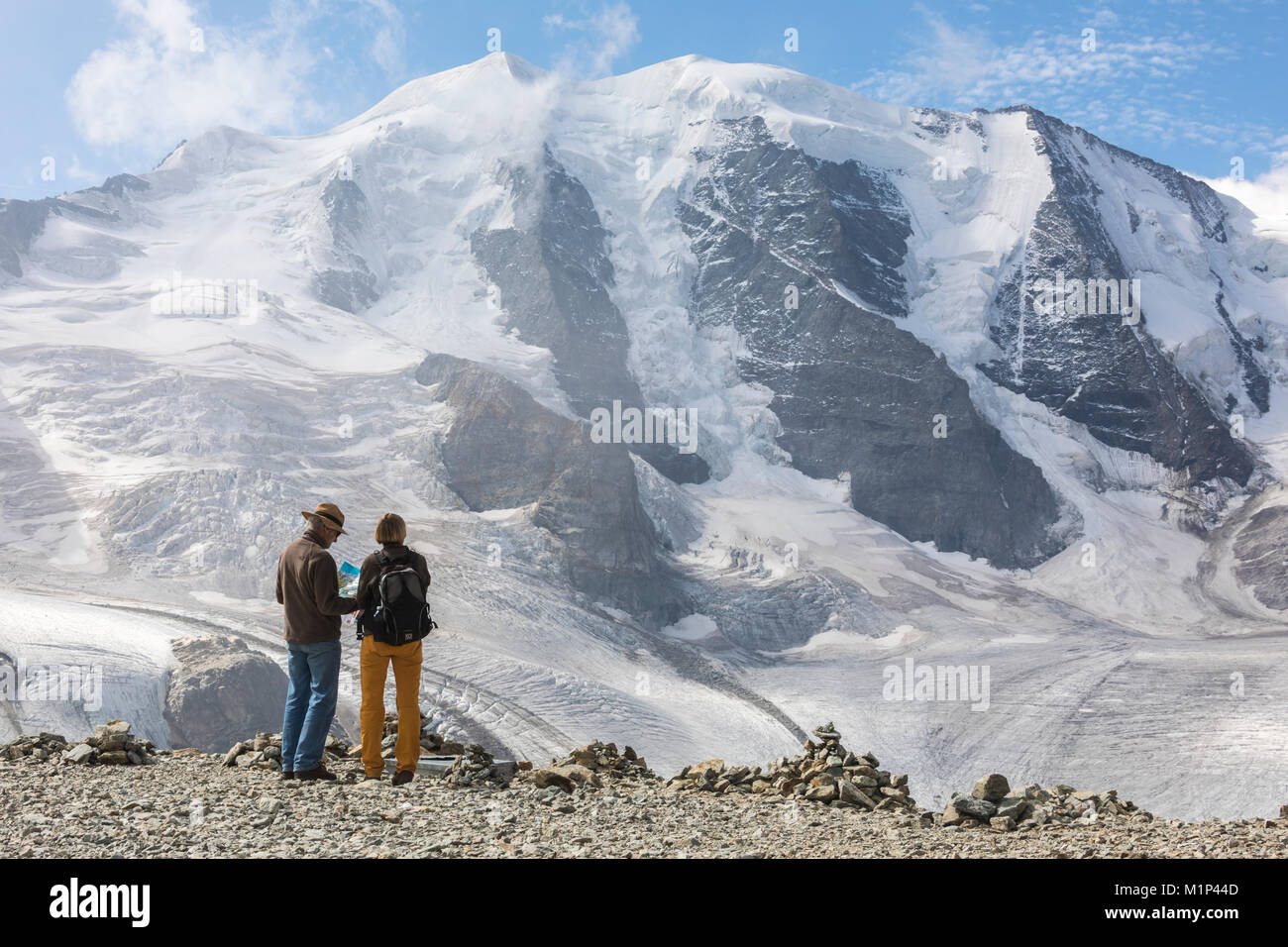 Tourists admire the Diavolezza and Pers glaciers and Piz Palu, St. Moritz, canton of Graubunden, Engadine, Switzerland, - Stock Image