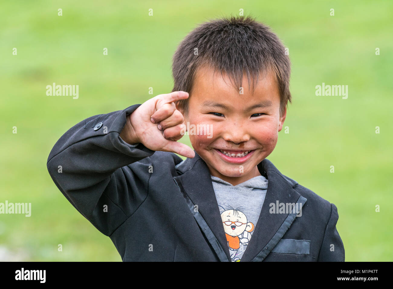 Portrait of a Mongolian nomadic little boy, North Hangay province, Mongolia, Central Asia, Asia - Stock Image
