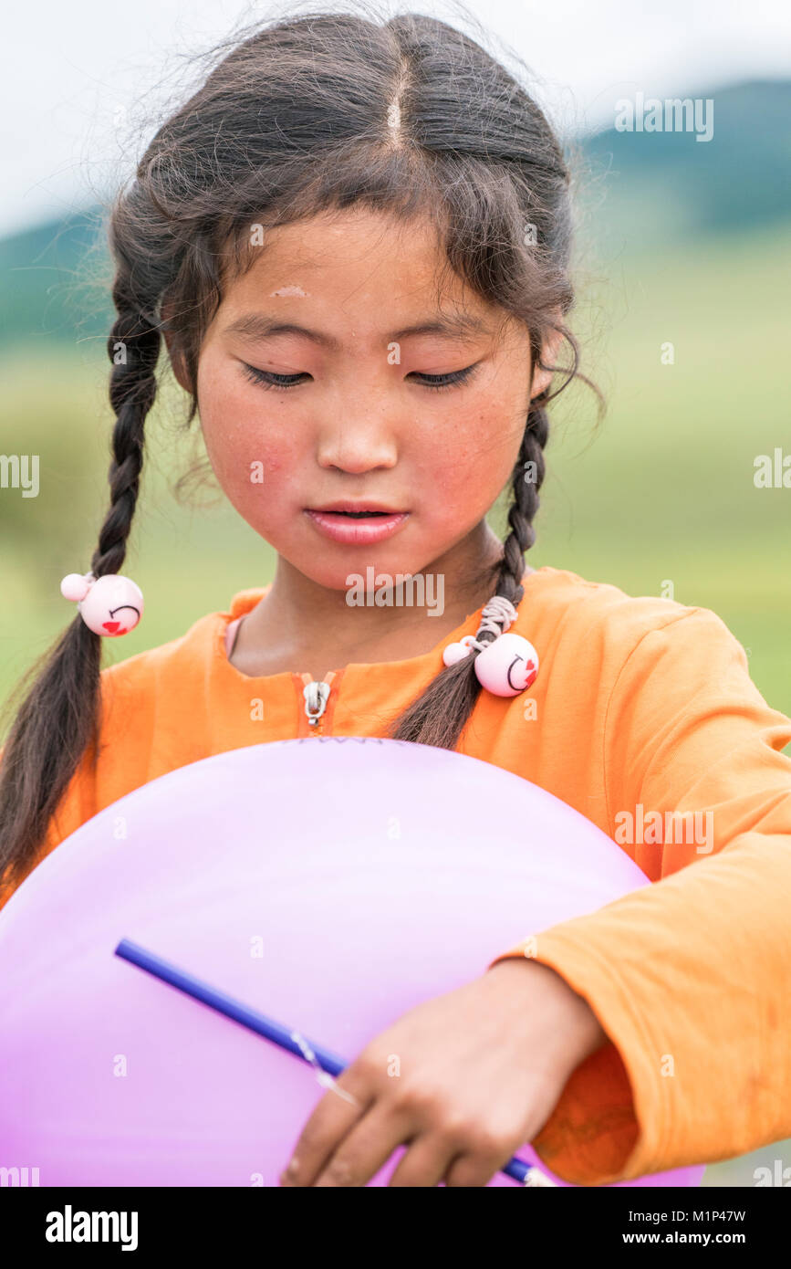 Portrait of a Mongolian Nomadic girl with braids, North Hangay province, Mongolia, Central Asia, Asia - Stock Image