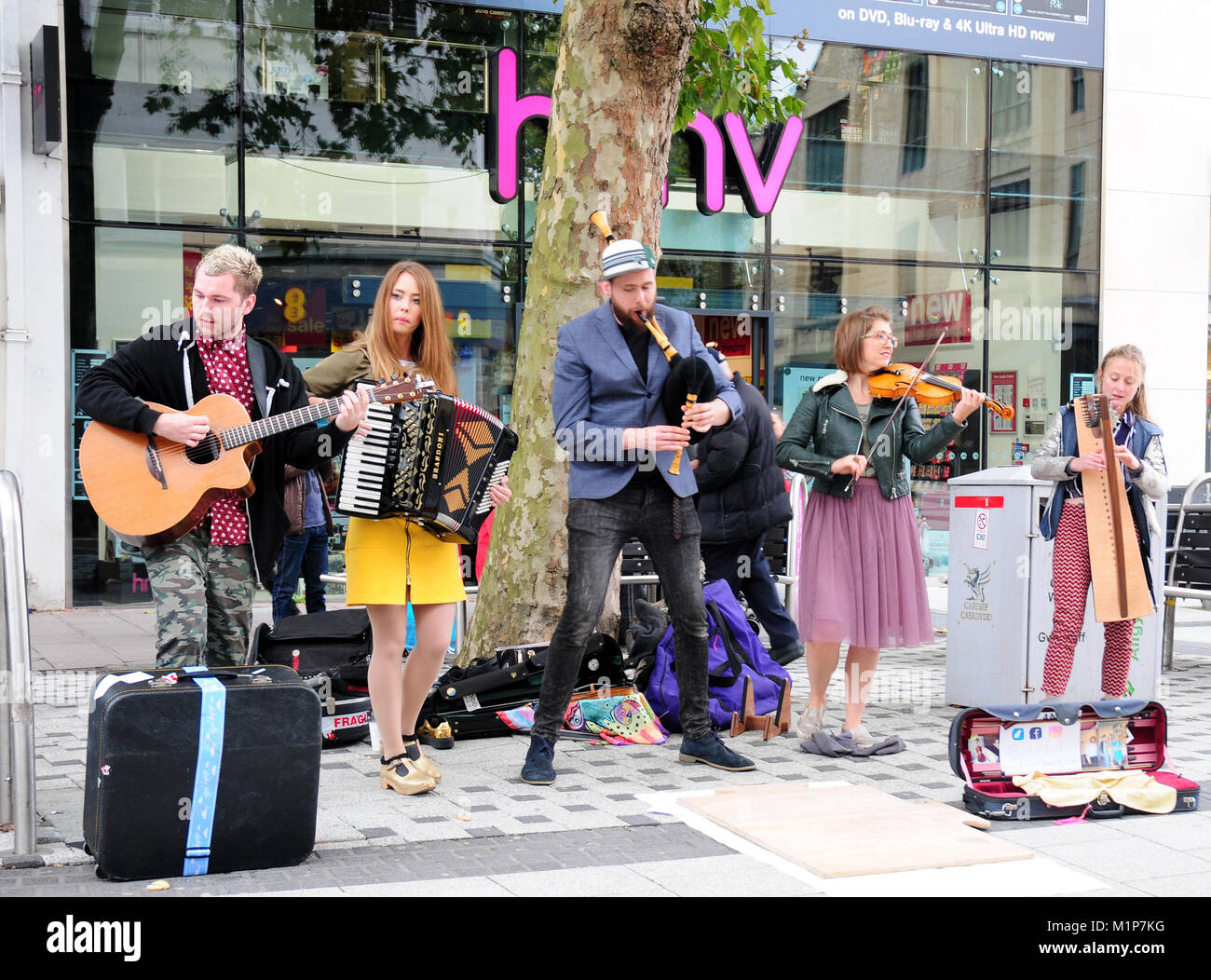 Folk group musicians playing in Cardiff shopping precinct. - Stock Image
