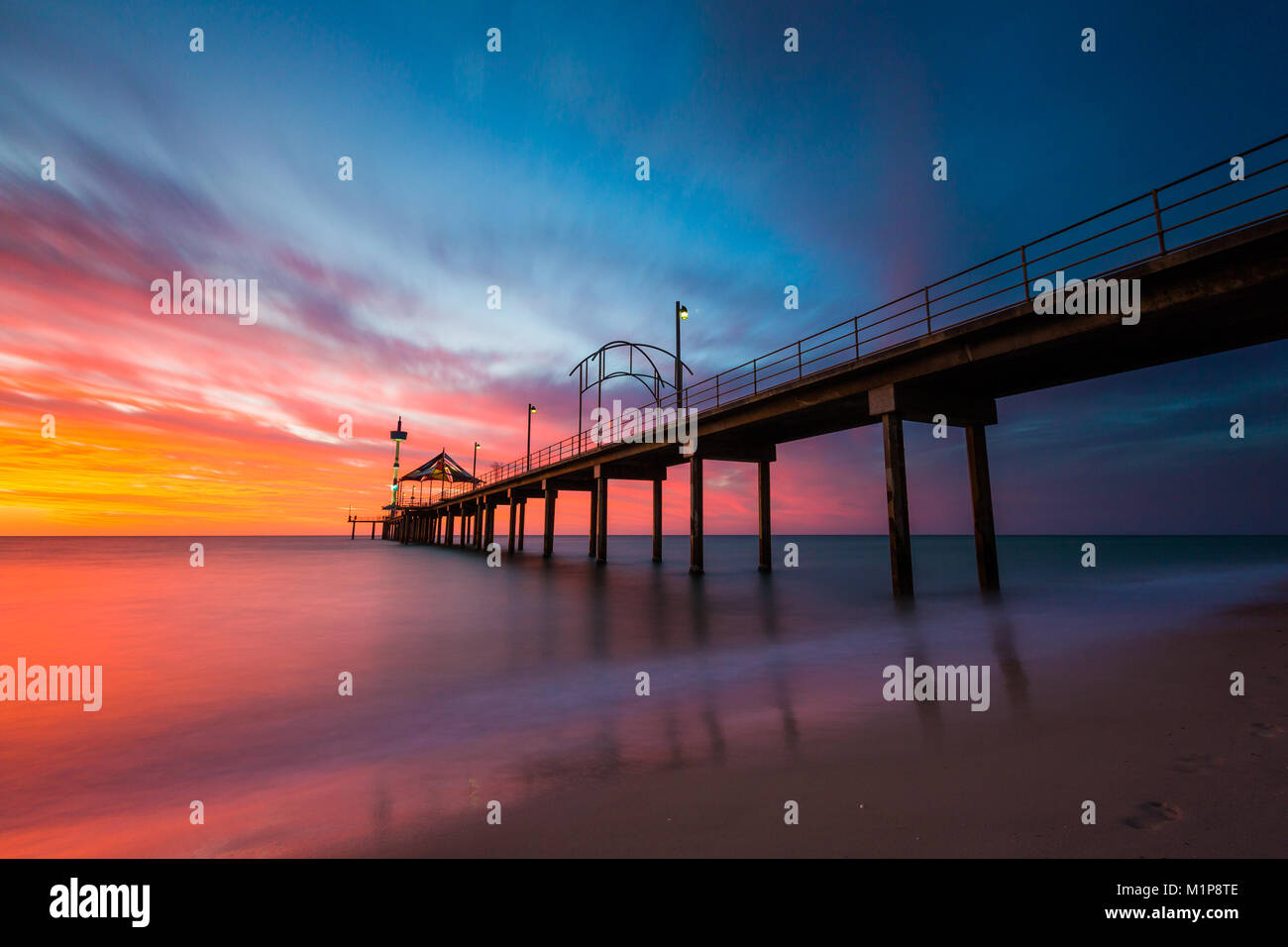 A vibrant sunset at Brighton Jetty in Brighton, Adelaide, South Australia, Australia on 1st February 2018 - Stock Image