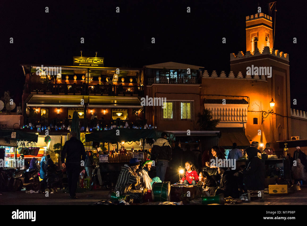 Marrakech,Morocco - January 2018:  Moroccan Berbers fairytale stories in Jamaa el Fna market square at night. Stock Photo