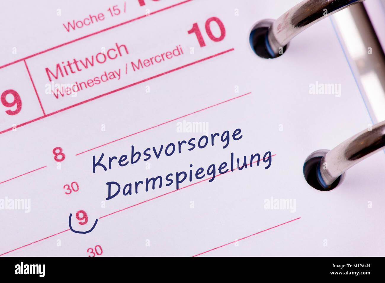 Terminkalender mit Eintrag Krebsvororge mit Darmspiegelung Stock Photo