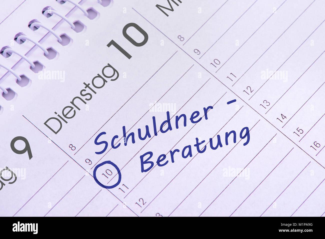 Schuldnerberatung Termin im Kalender Stock Photo
