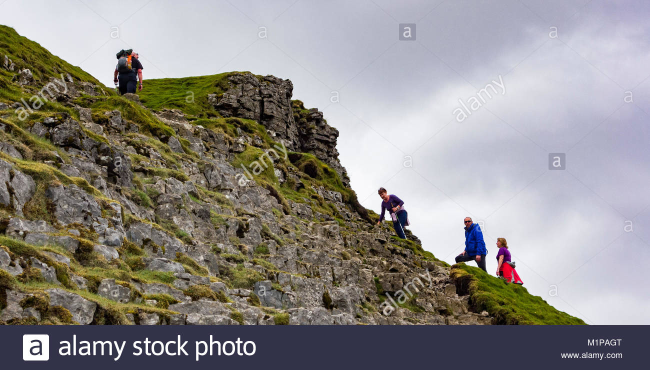 Climbing to the top of Pen y Ghent, one of the Yorkshire Three Peaks, near to Horton in Ribblesdale in the Yorkshire - Stock Image