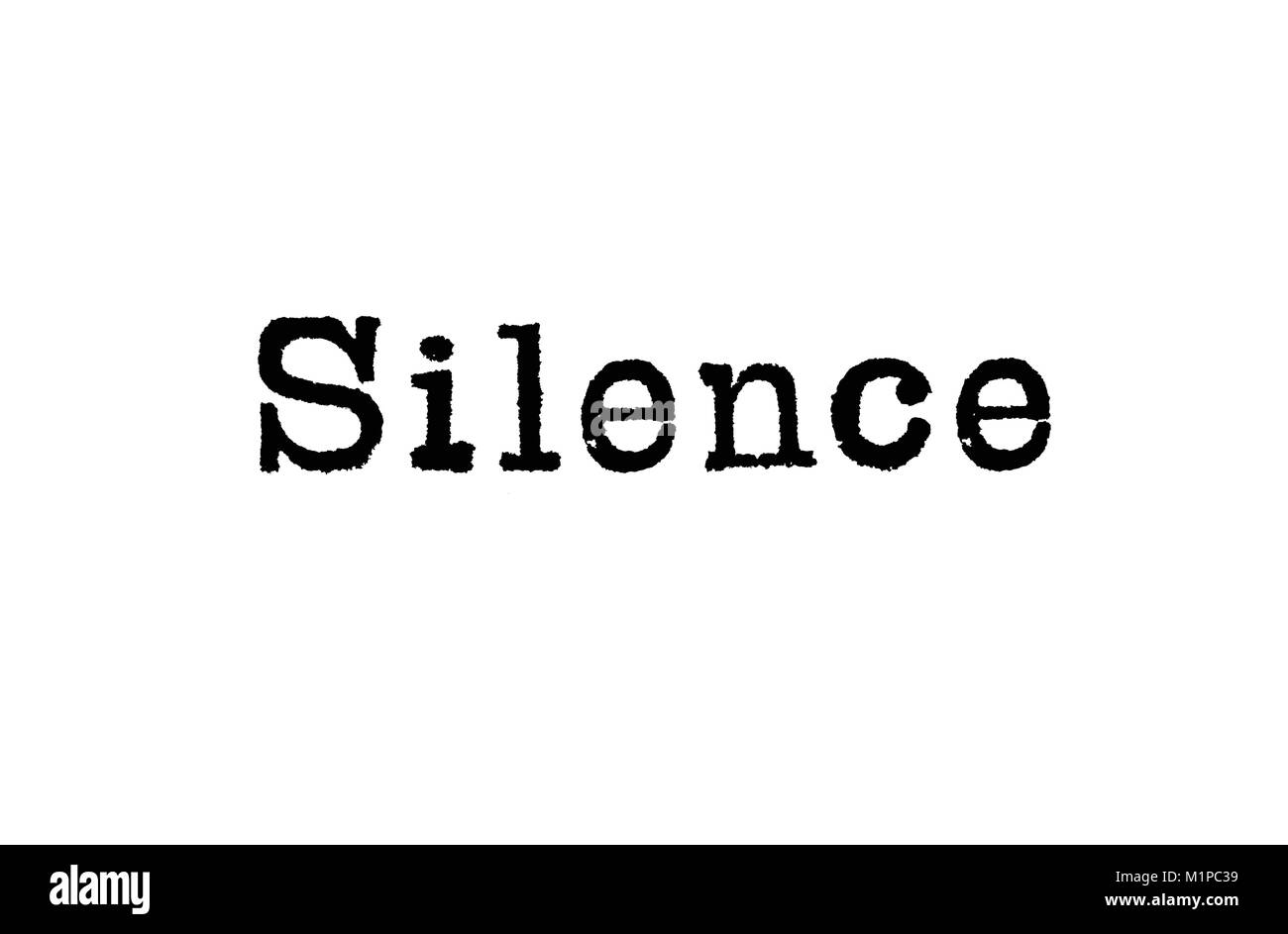The word Silence from a typewriter on a white background - Stock Image
