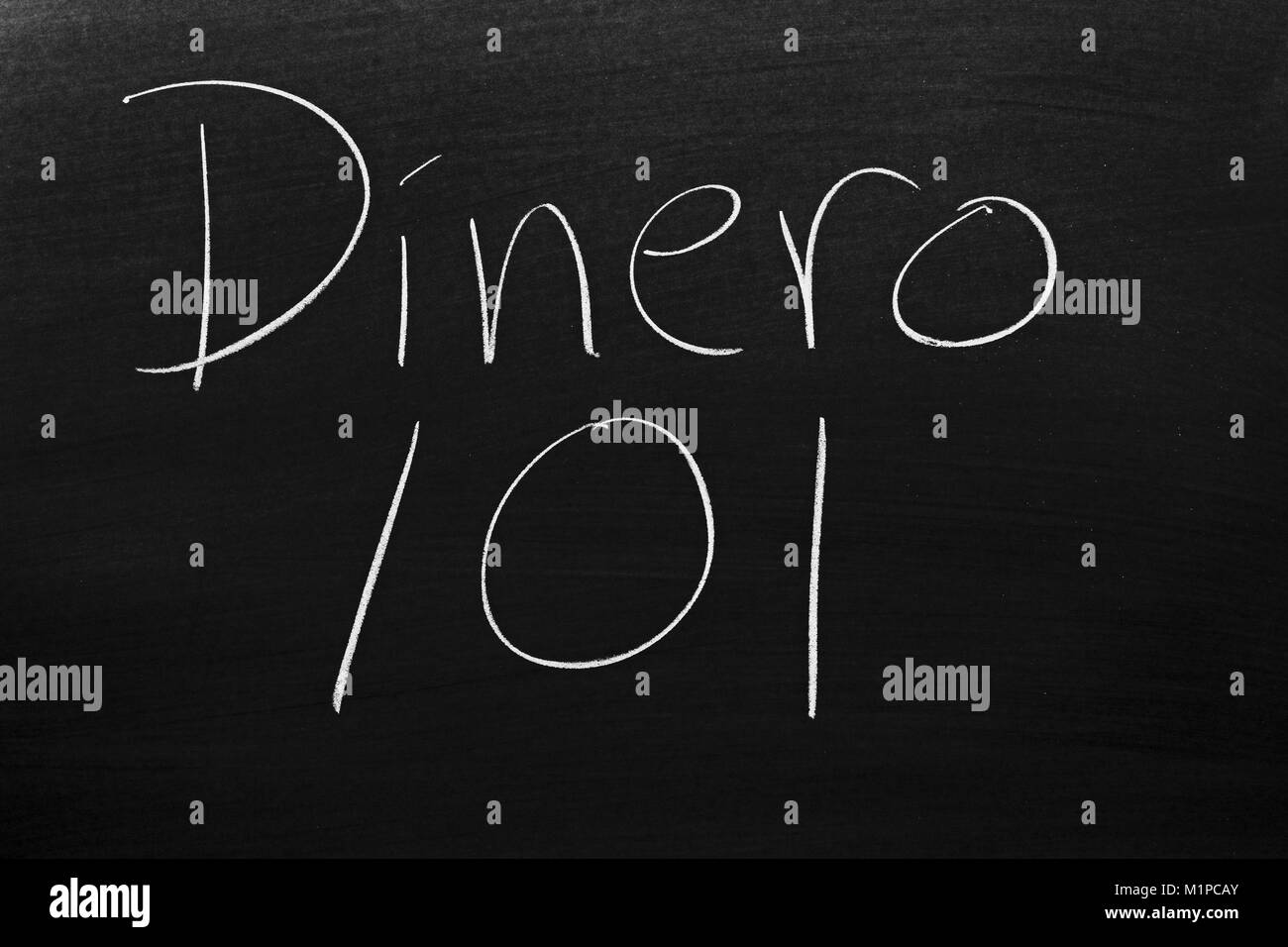 The words Dinero 101 on a blackboard in chalk - Stock Image