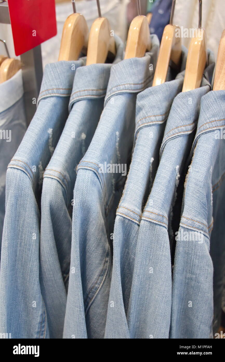 Closed Up Denim shirt in the shopping mall - Stock Image