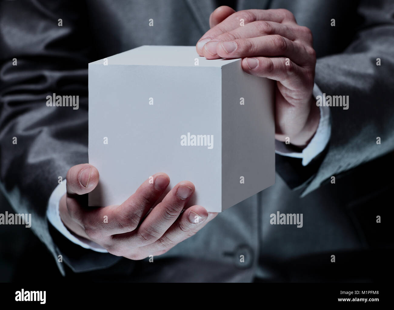 Cube in the male hands. - Stock Image