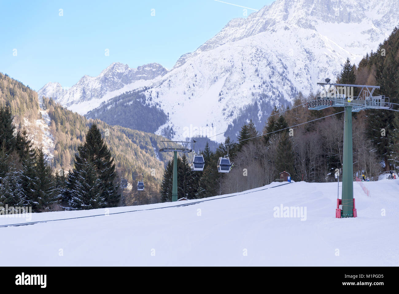 Cableway lift cable cars, gondola cabins on winter snowy mountains background beautiful scenery. - Stock Image