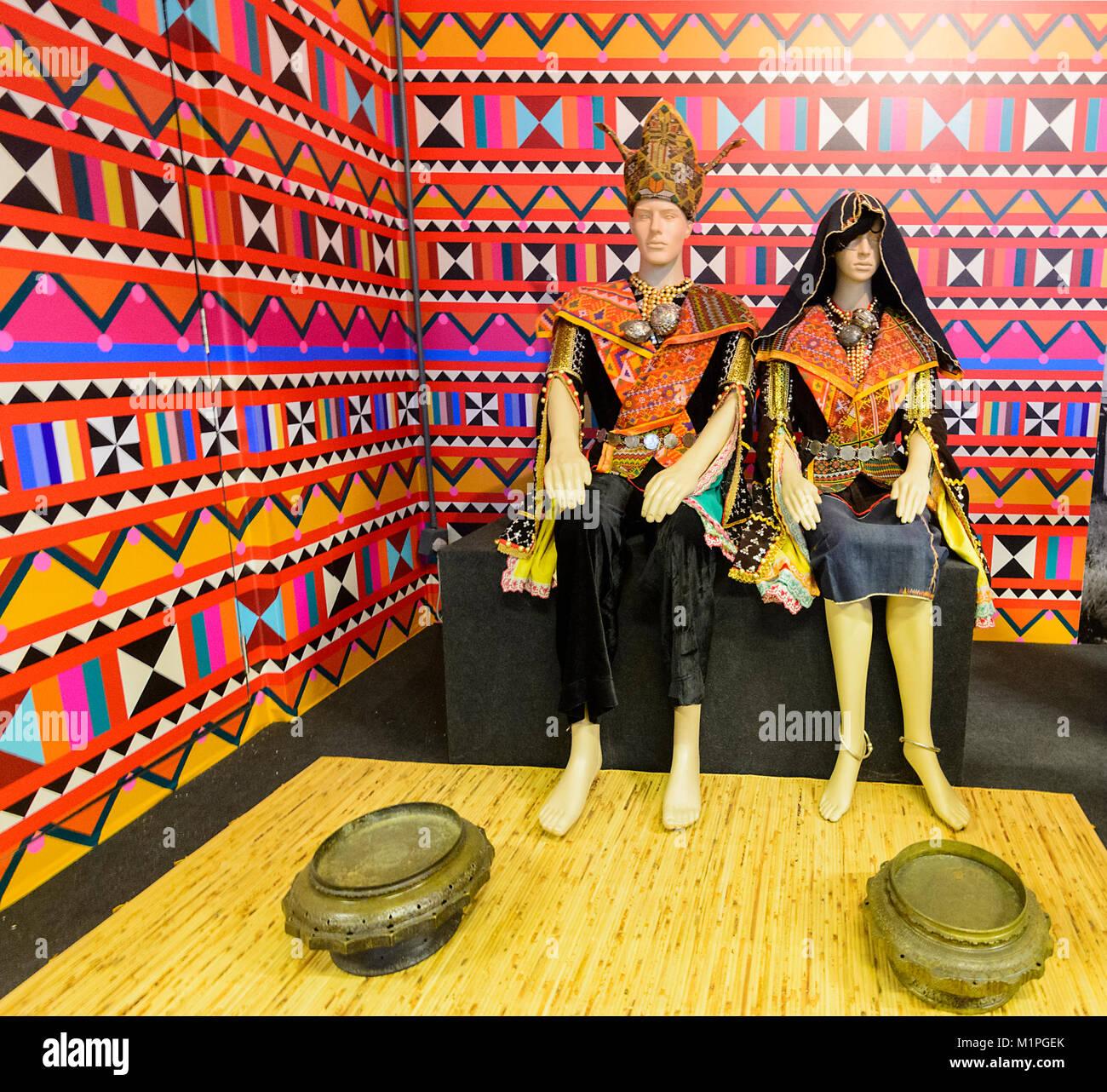 Couple dressed for a Dusun Tindal wedding at the Muzium Sabah, Kota Kinabalu, Sabah, Borneo, Malaysia - Stock Image