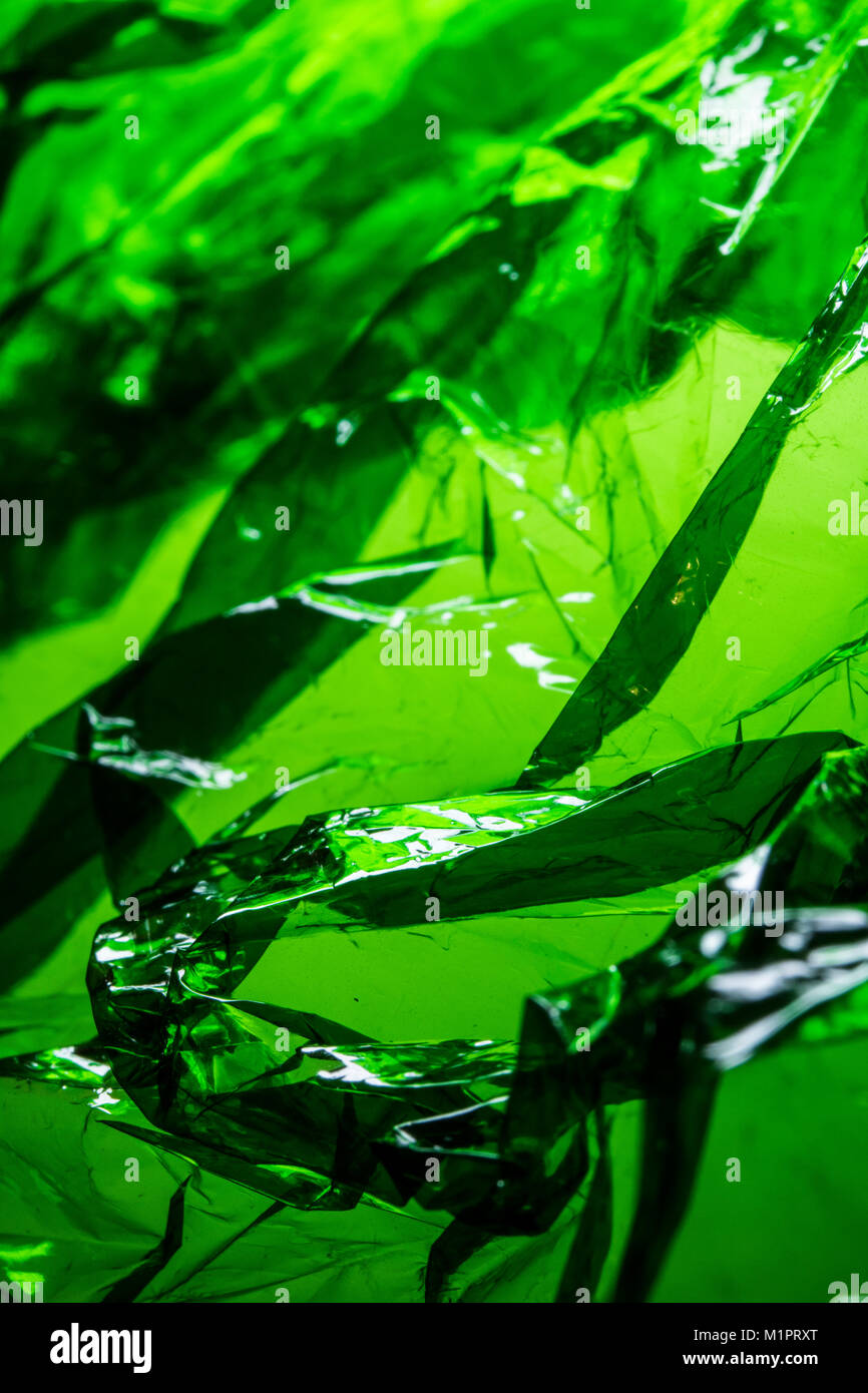 Plastic Shiny See Through Abstract Shimmer Creased Background - Stock Image