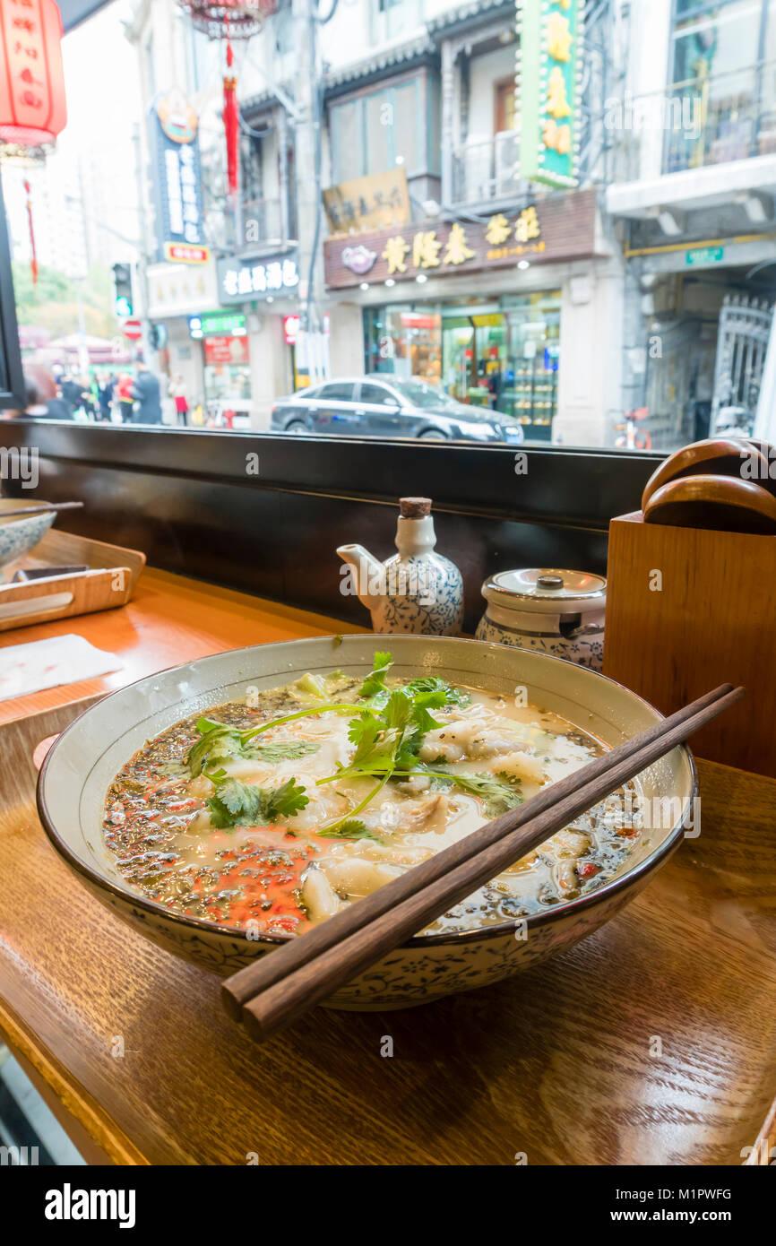Enjoying traditional Shanghai noodle soup - Stock Image