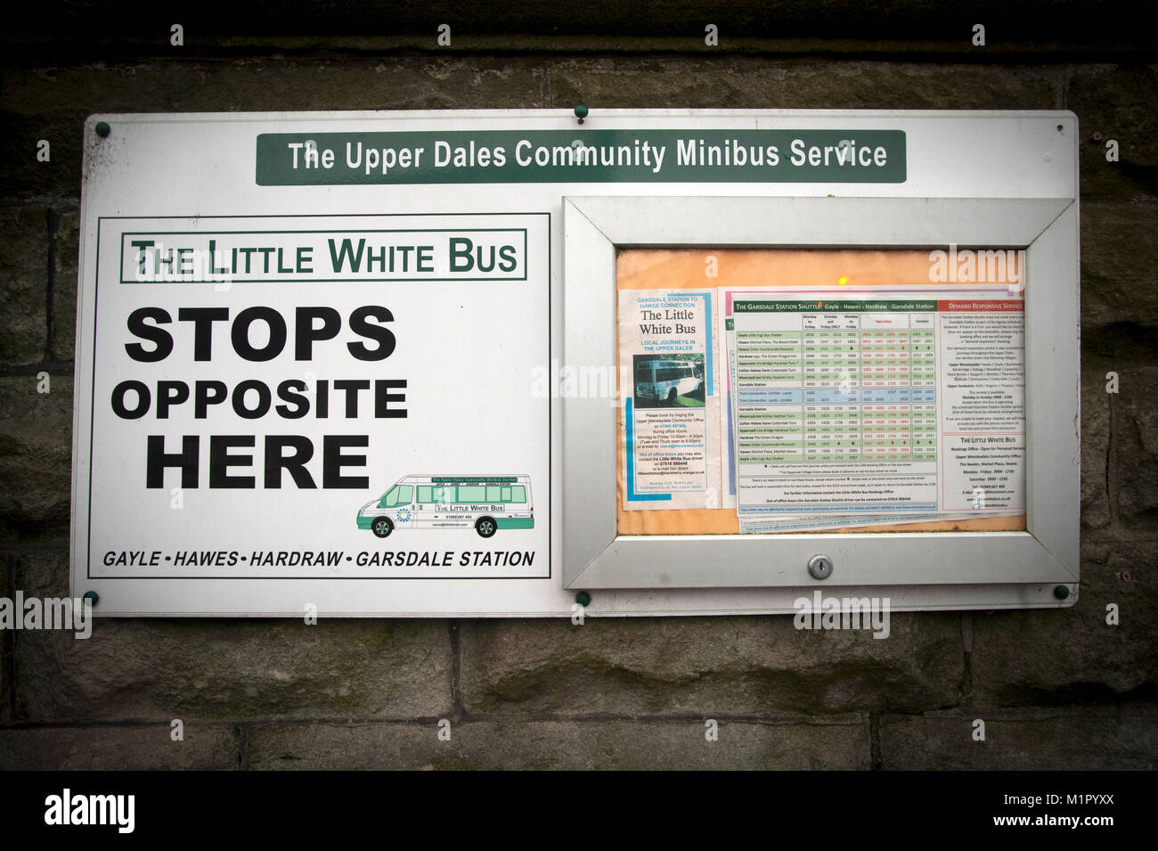 Notice in Hawes for the bus stop for The Little White Bus service. - Stock Image
