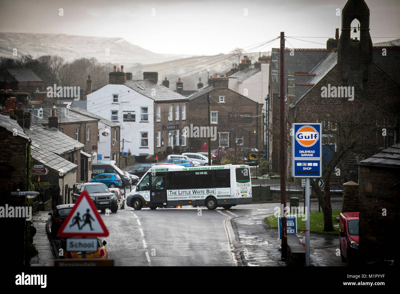 The Little White Bus turning into Looking into the Market Place at Hawes. Stock Photo