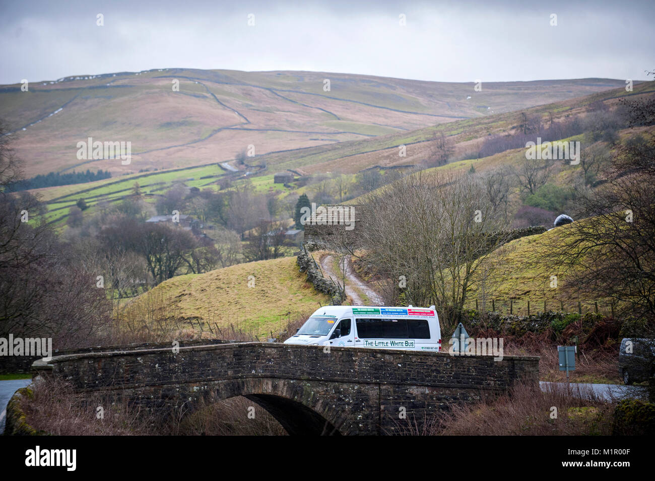 The Little White Bus crossing the bridge into Muker on its Swaledale Shuttle run. Stock Photo
