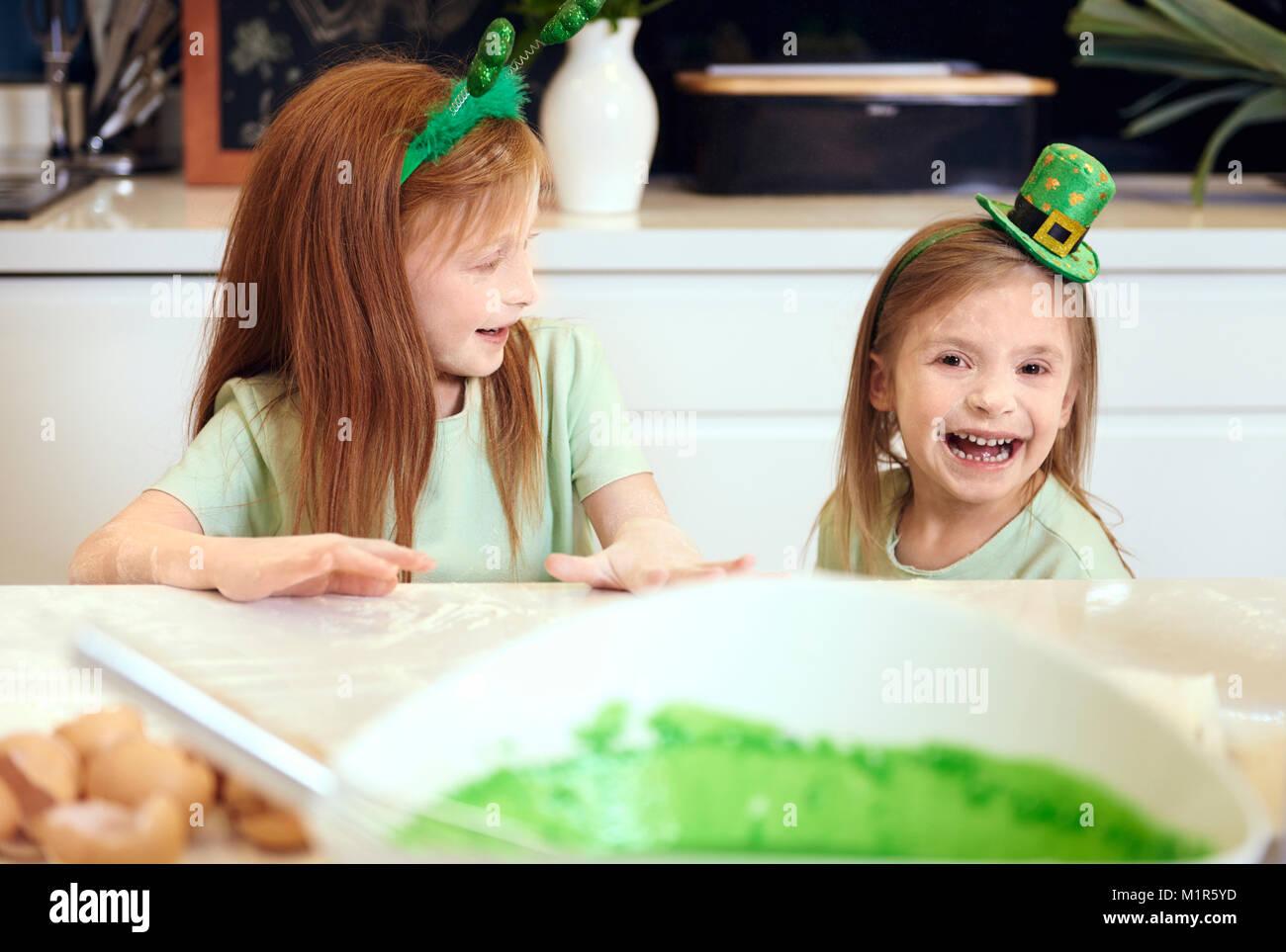Cheerful siblings having a fun at kitchen - Stock Image