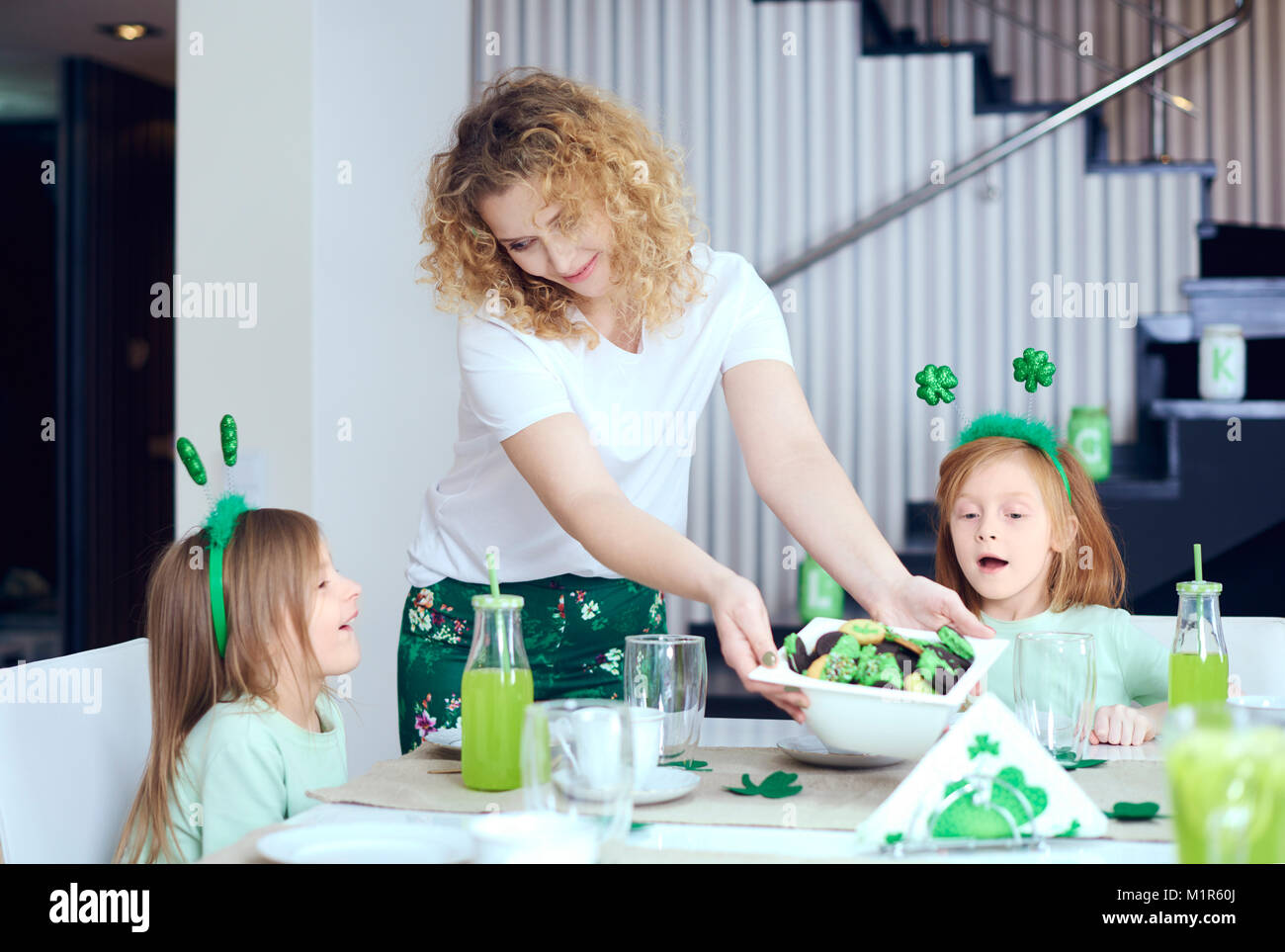 Mother and her children at kitchen - Stock Image