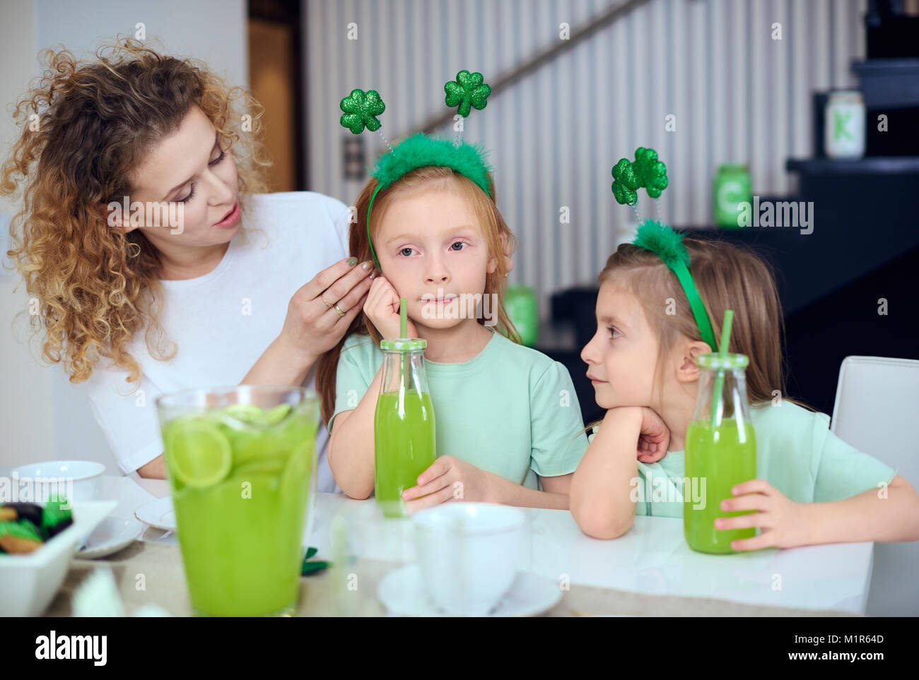 Mother with children spending time at kitchen - Stock Image