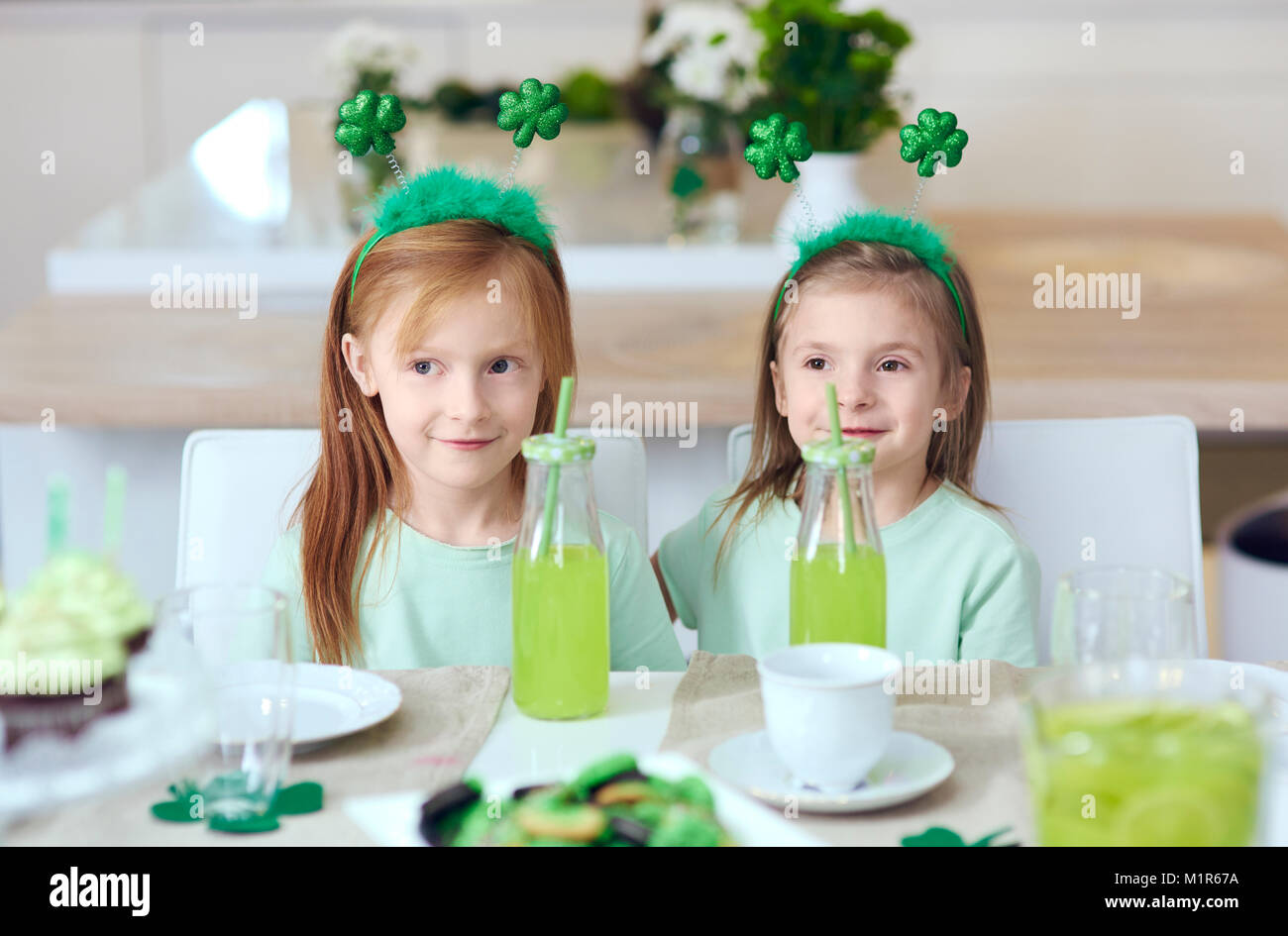 Portrait of siblings at irish party - Stock Image