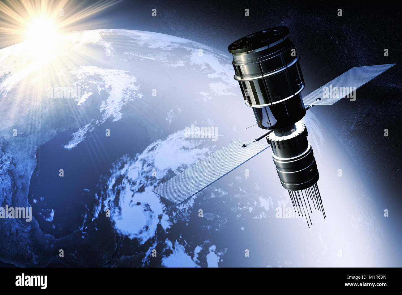 Satellite orbiting the earth at dawn - Stock Image