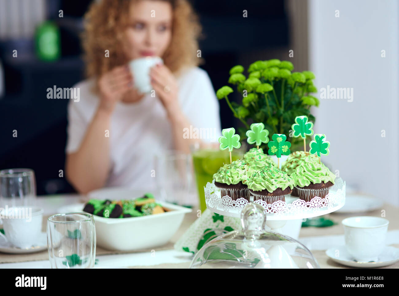 Table with sweet food at irish party - Stock Image