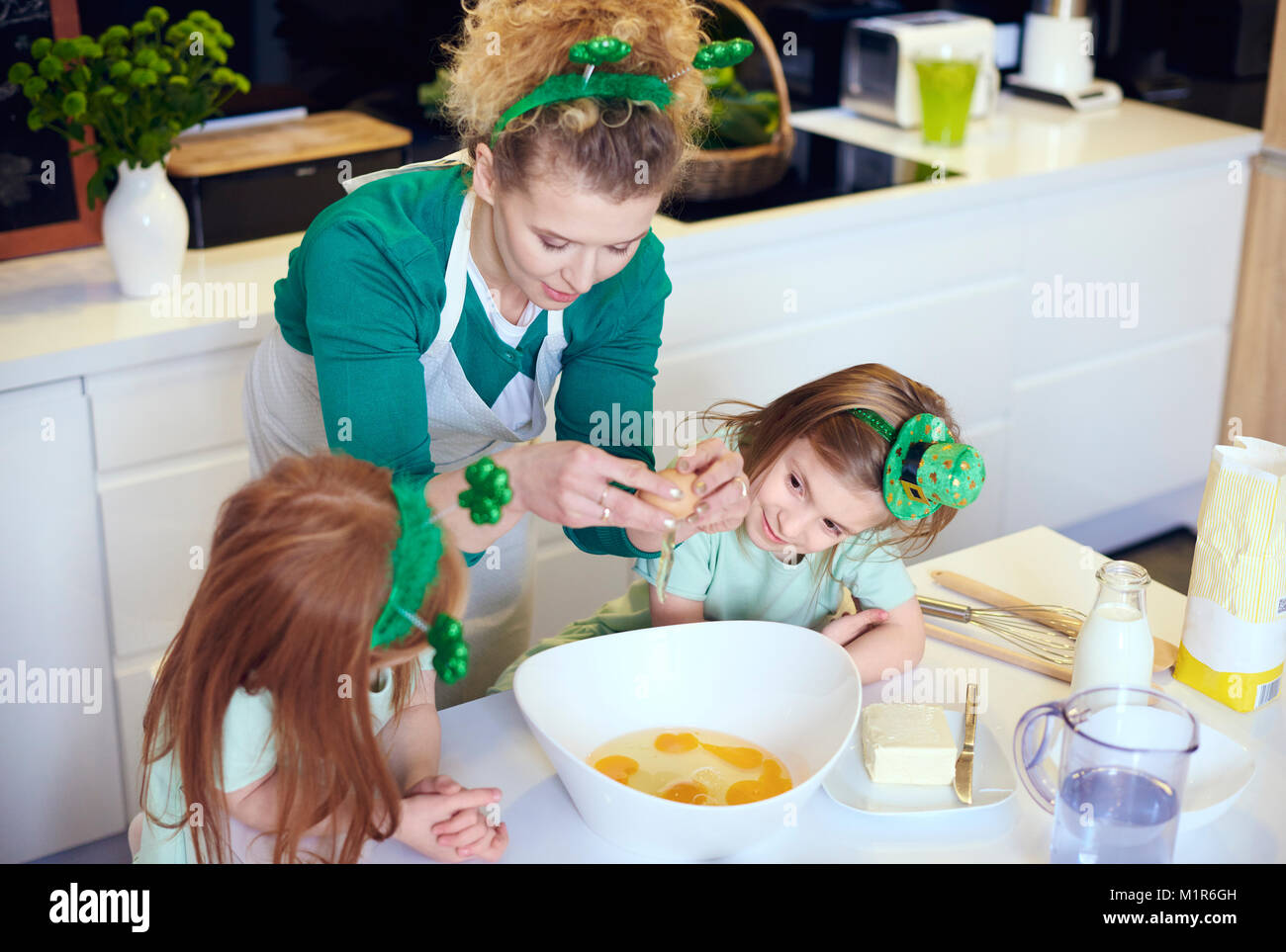 Interested children learning how to cook - Stock Image
