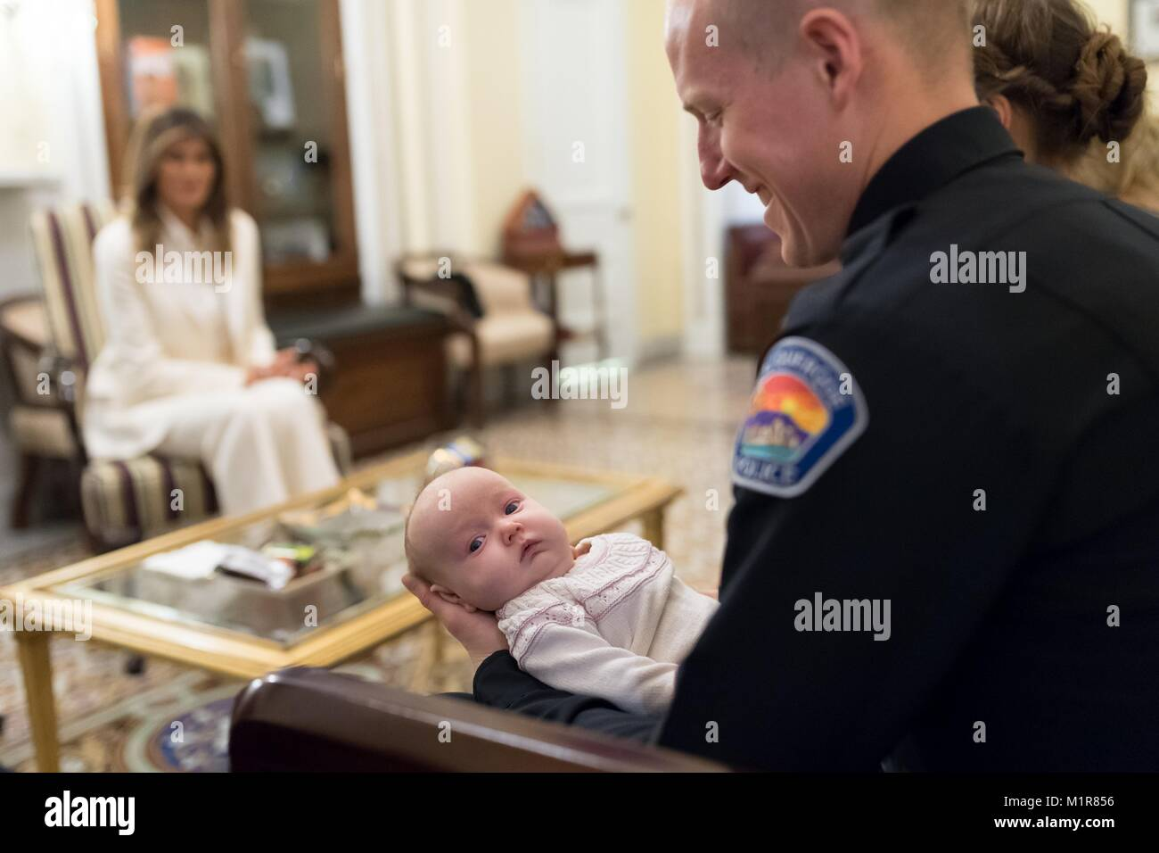 Albuquerque Police Officer Ryan Holets holds his adopted baby girl, Hope, as U.S First Lady Melania Trump hosts Stock Photo