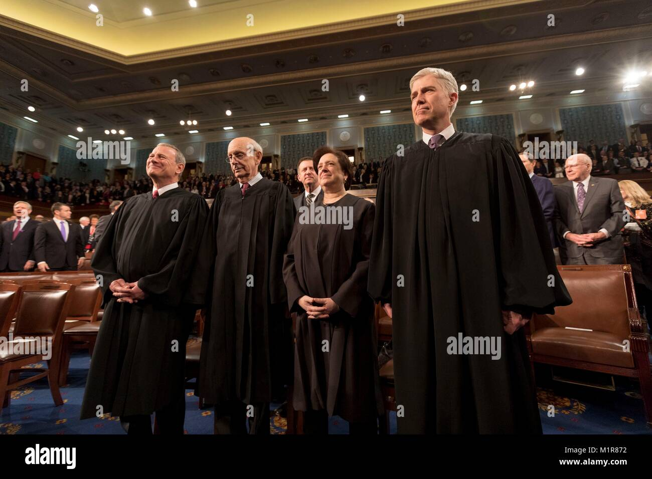 Justices of the U.S Supreme Court stand as President Donald Trump arrives for his first State of the Union address - Stock Image