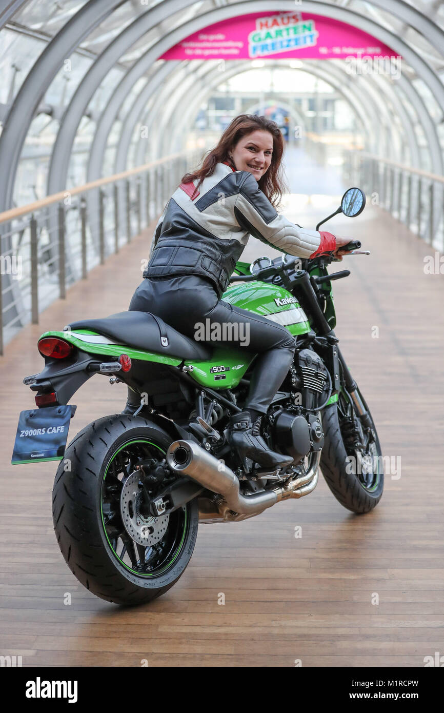 Model Louisa Sits On A Kawasaki Z900 RS Cafe Motorcycle At The Fair In Leipzig Germany 1 February 2018