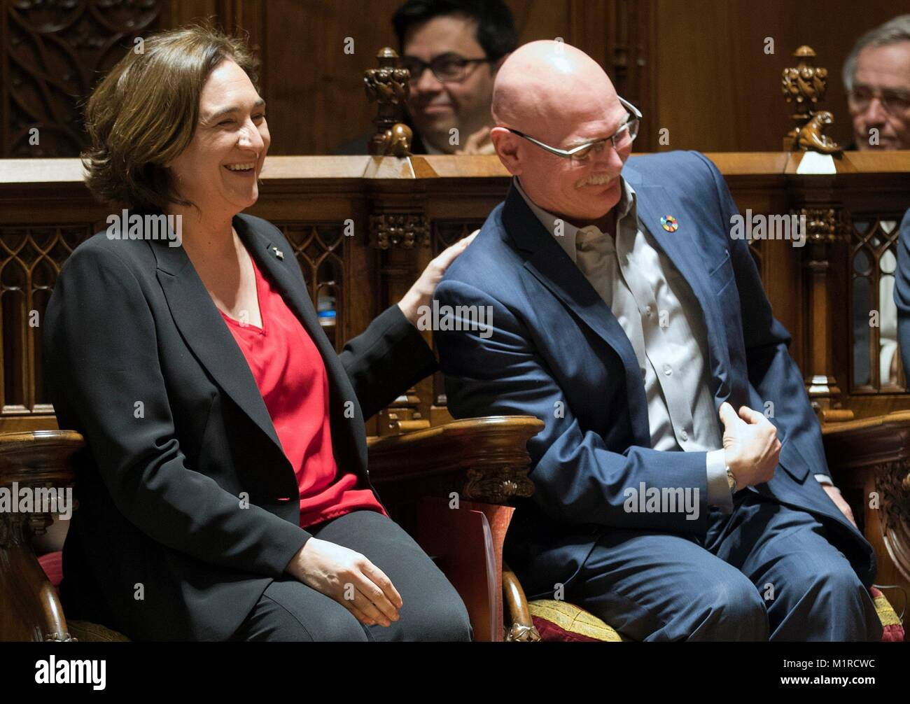Barcelona, Spain. 01st Feb, 2018. Barcelona city's Mayoress Ada Colau (L) chats with the CEO of GSMA, John Hoffmann, - Stock Image