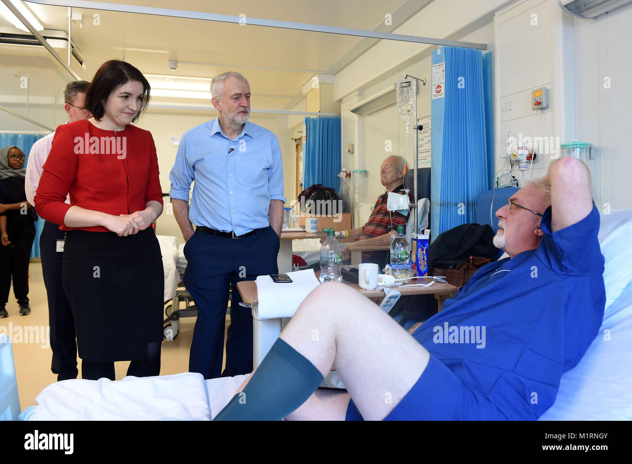 Labour leader Jeremy Corbyn meets patient Nev Brown during a visit to Milton Keynes University Hospital with newly - Stock Image