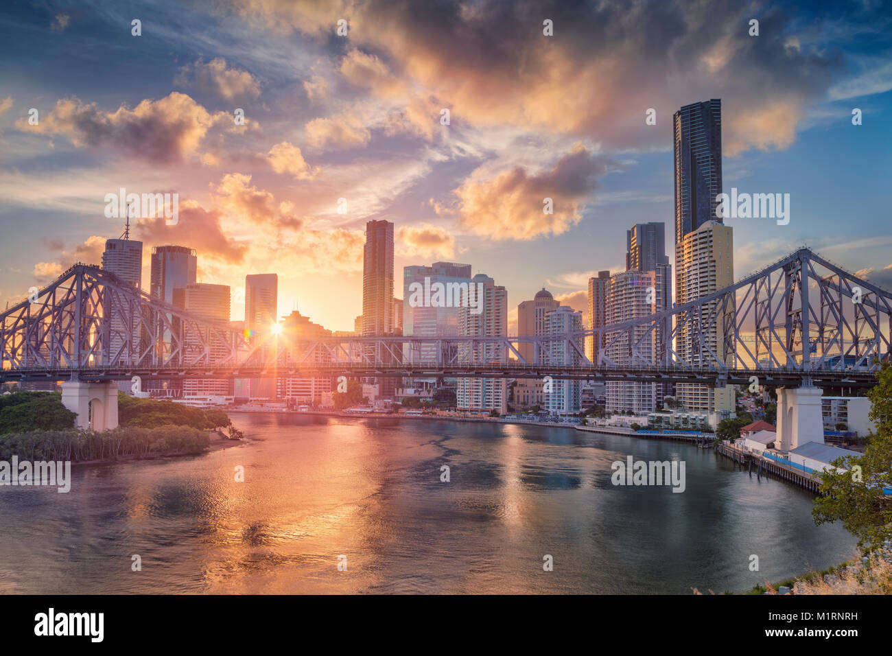 Brisbane. Cityscape image of Brisbane skyline, Australia with Story Bridge during dramatic sunset. - Stock Image