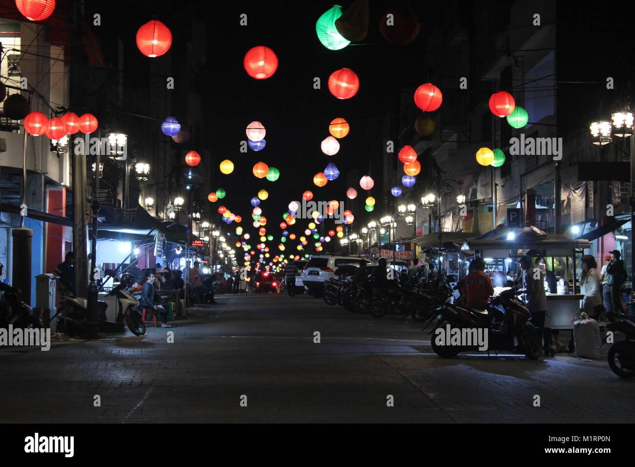 Lanterns illuminate Jalan Cibadak. Bandung, Indonesia, Southeast Asia. - Stock Image